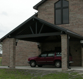 pitched roof carport with red jeep underneath