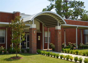 curved aluminum canopy at school entrance