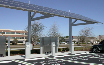 solar panels positioned over electric car parking stations